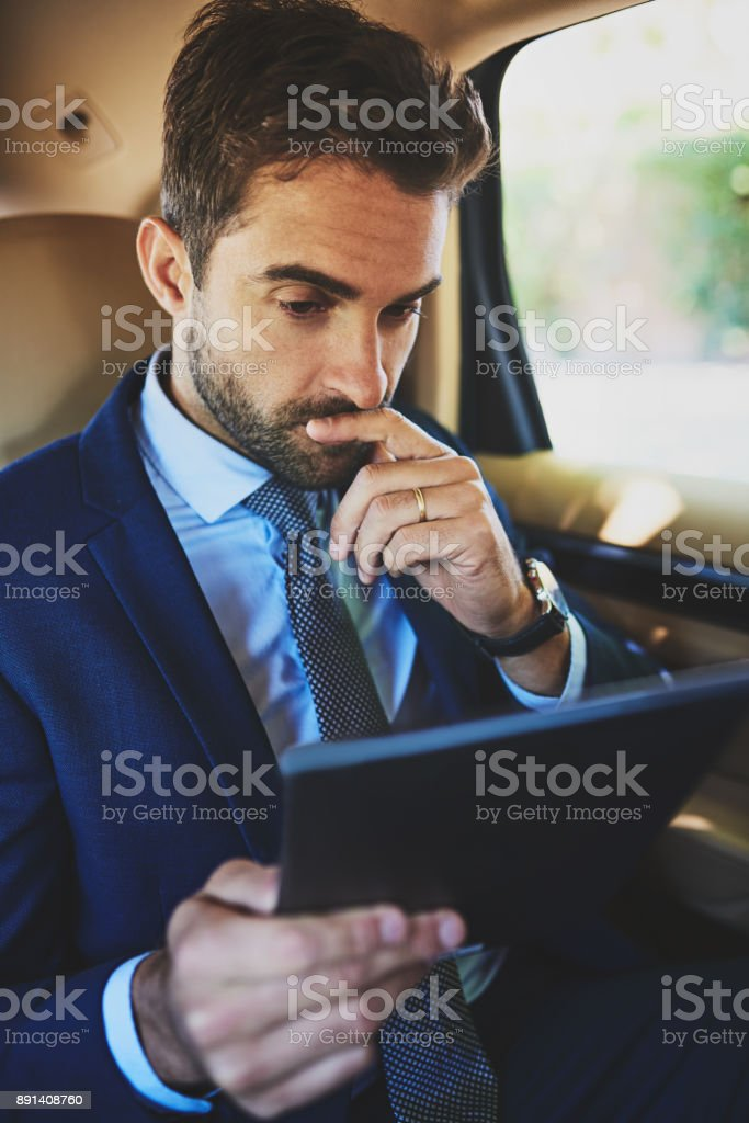 Even when he's in a car he works stock photo