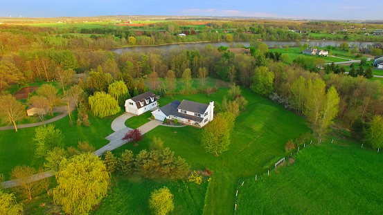 Evening aerial view of scenic rural home in Springtime