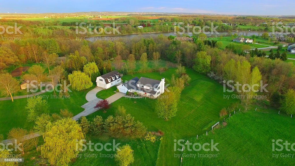 Evening aerial view of scenic rural home in Springtime stock photo
