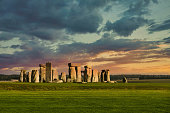 Amesbury, United Kingdom - Mar 18, 2019: Historic Stonehenge late in the day on typical cloudy misty English day as tourist from around the world visit the iconic monument.