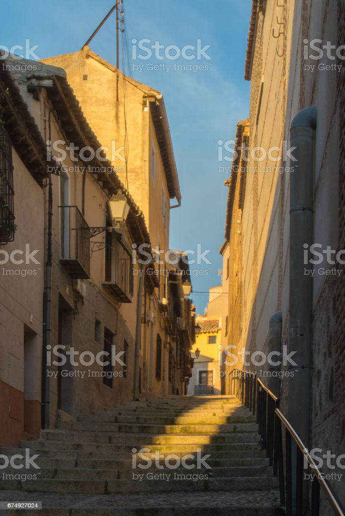 Evening at the streets of old town of Toledo, falling light at the stairs. royalty-free stock photo
