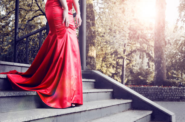 evening ball in a red dress - prom stock photos and pictures