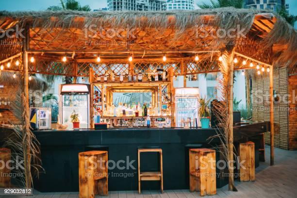 Evening bar in form of tropics on sea coast picture id929032812?b=1&k=6&m=929032812&s=612x612&h=mg0nbztow6ibrozgpkdnusssgs1kgx44ze rrhwn1xq=