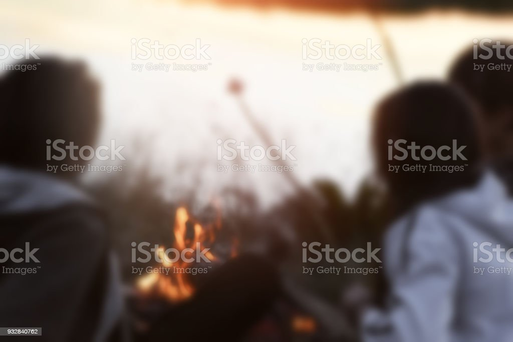 Evening campfire with kids.Blurry image. stock photo