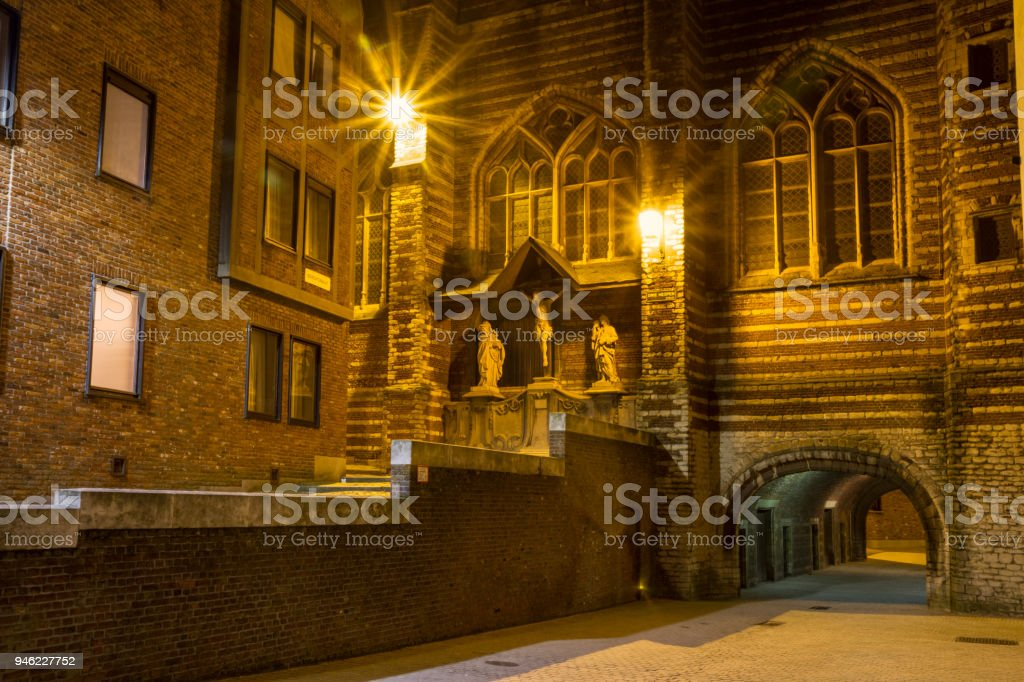 Evening cityscape - view of The Vleeshuis and sculptural group referring to the theme of Calvary (Christ, Mary, John), in Antwerp stock photo