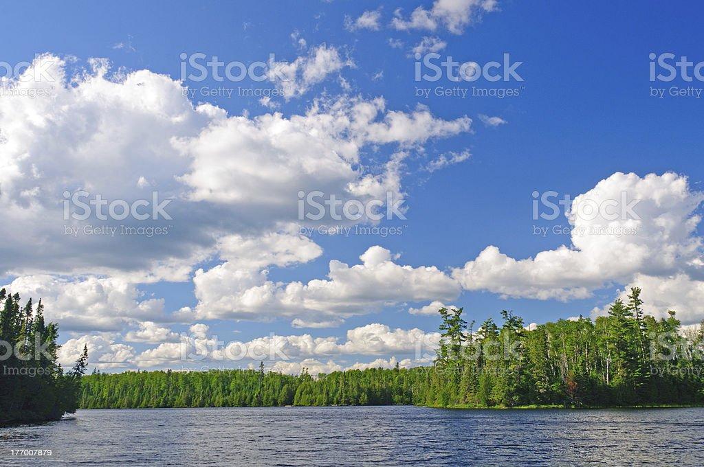 Evening clouds on Horseshoe Lake stock photo