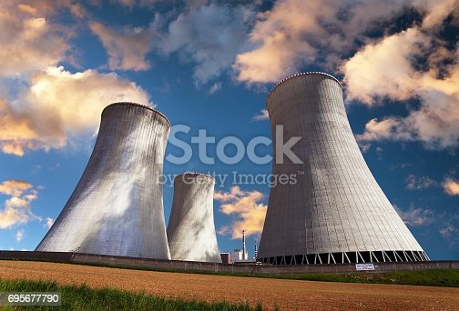 istock Evening colored view of cooling tower - Nuclear power 695677790