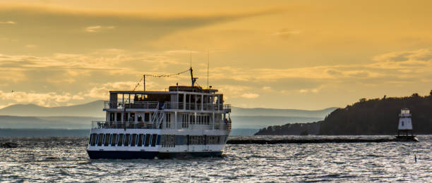 evening cruise leaving Lake Champlain waterfront stock photo