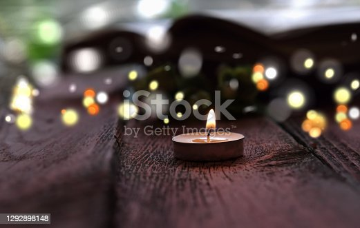 evening dark twilight burning melting candle. decorative blurred festive  bokeh. at home, cozy lazy evening time
