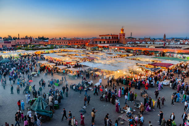 Evening Djemaa El Fna Square with Koutoubia Mosque, Marrakech, Morocco,North Africa stock photo