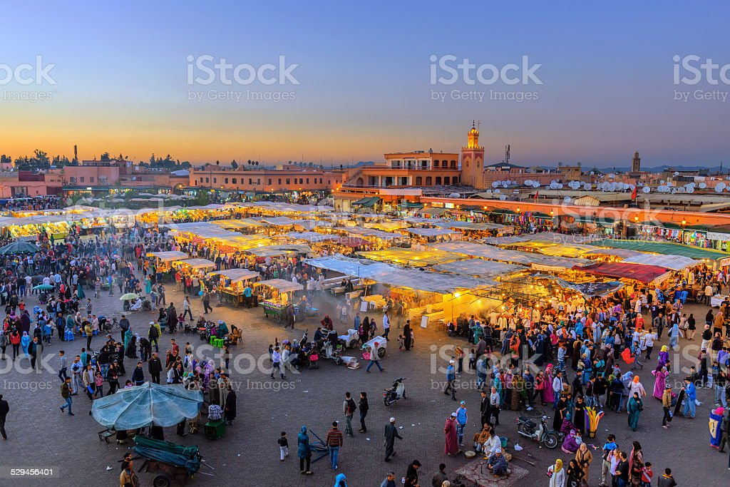 Evening Djemaa El Fna Square with Koutoubia Mosque, Marrakech, Morocco Famous Djemaa El Fna Square in early evening light, Marrakech, Morocco with the Koutoubia Mosque, Northern Africa.Nikon D3x Africa Stock Photo