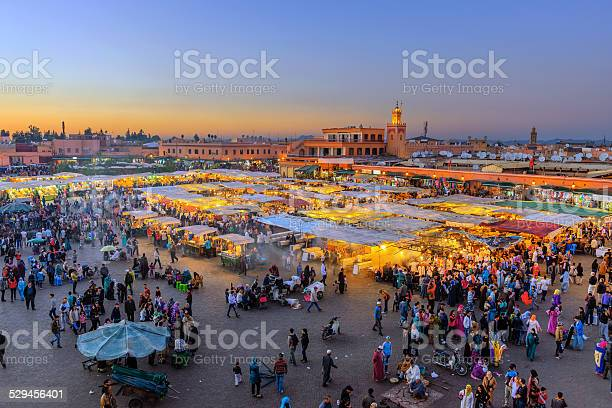 Evening Djemaa El Fna Square With Koutoubia Mosque Marrakech Morocco Stock Photo - Download Image Now