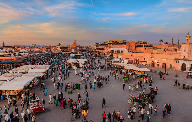 Evening Djemaa El Fna Square with Koutoubia Mosque,Marrakech, Morocco,North Africa stock photo