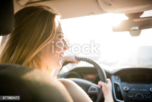 607592606 istock photo Evening drive - teenager at car 577960472
