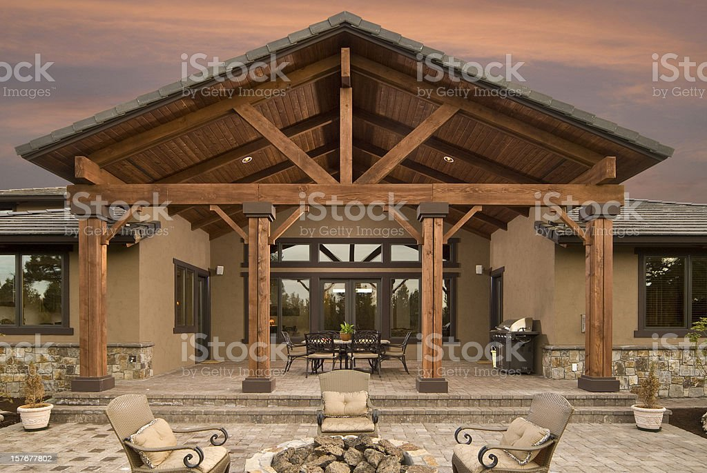 Evening exterior of home and deck stock photo