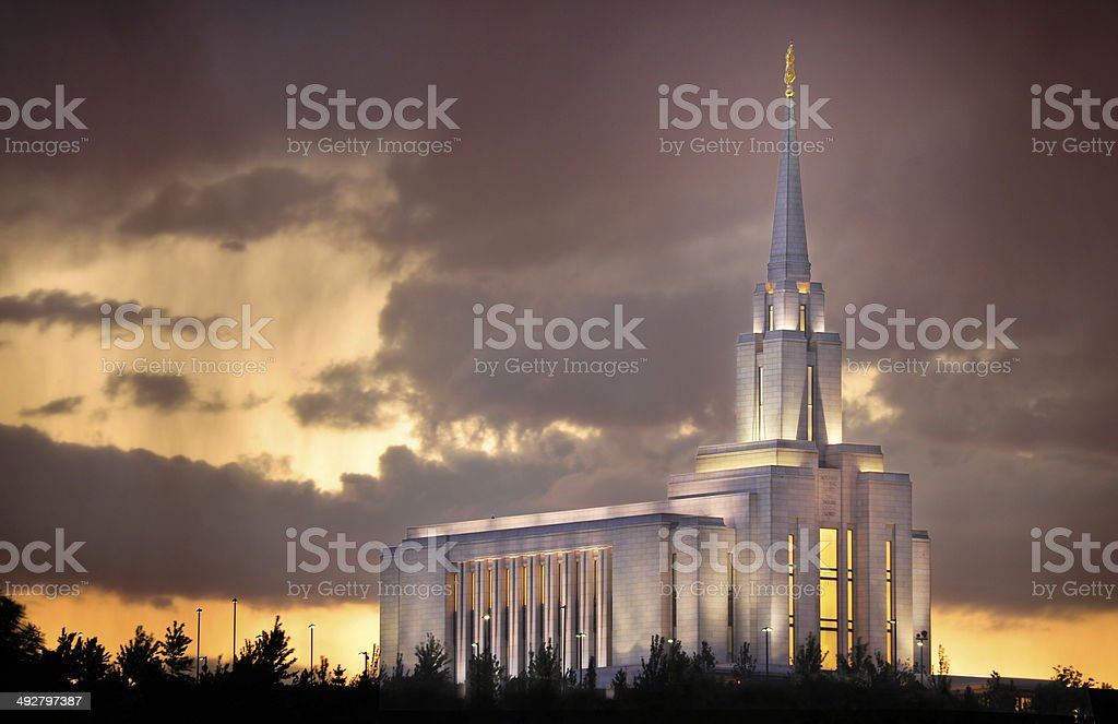 The evening glow of the Oquirrh Mountain Temple of the Church of...