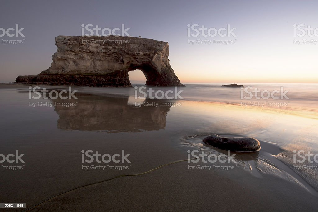 Setting suns sets the wet sand aflame in color at Natural Bridges...