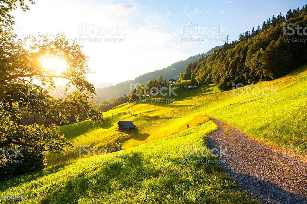 evening hour atmosphere in the swiss alps stock photo