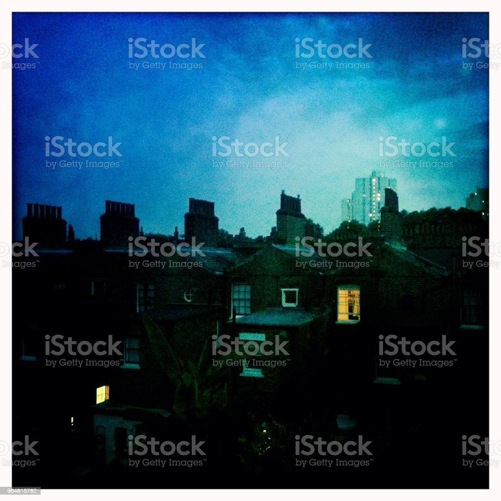 Evening illuminated windows London royalty-free stock photo