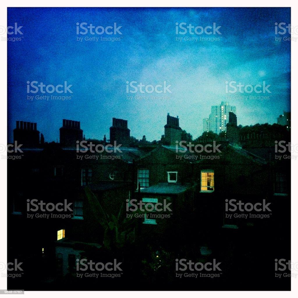 Evening illuminated windows London royalty-free stock photo