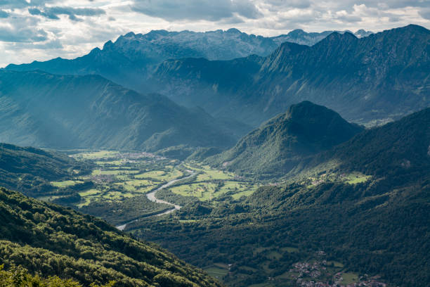 Evening in Soca valley. Popular summer vacation destination in Slovenia. View to Kobarid town with surrounding mountains