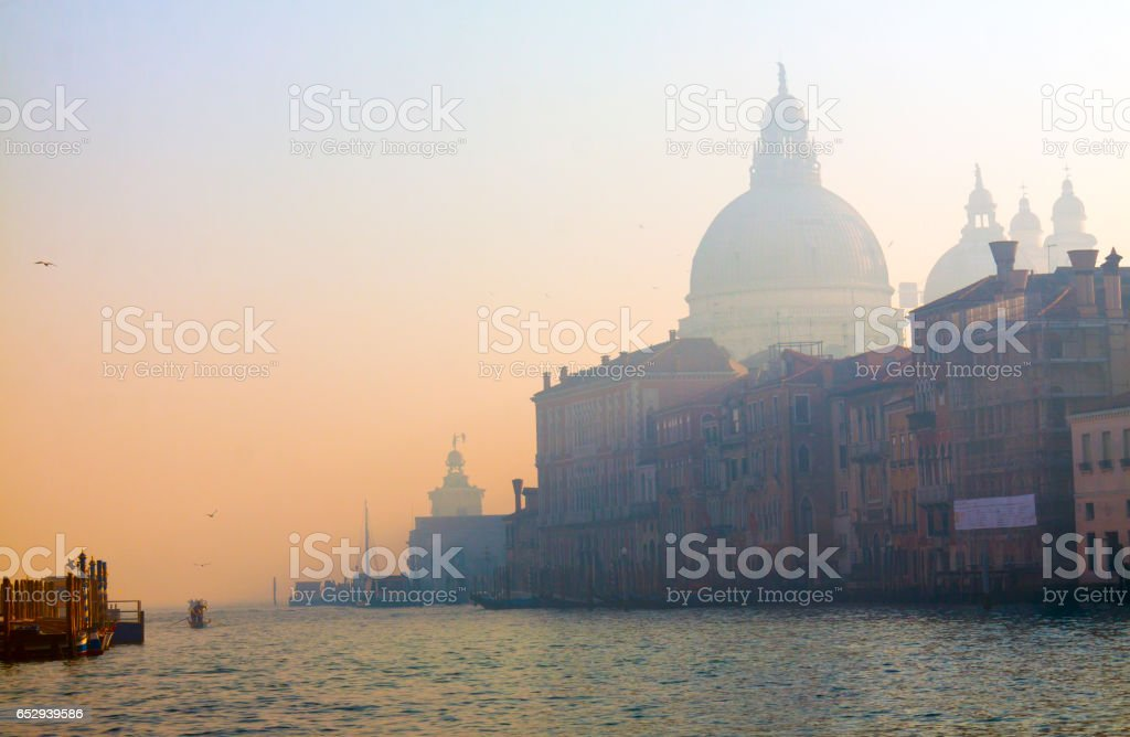 Evening in the misty Venice, city of canals and bridges stock photo