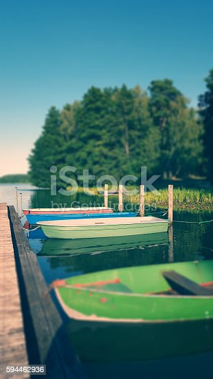 landing stage in morning light at a lake in Mecklenburg, Germany.