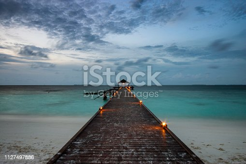 Evening descends upon a tropical island in the Maldives.