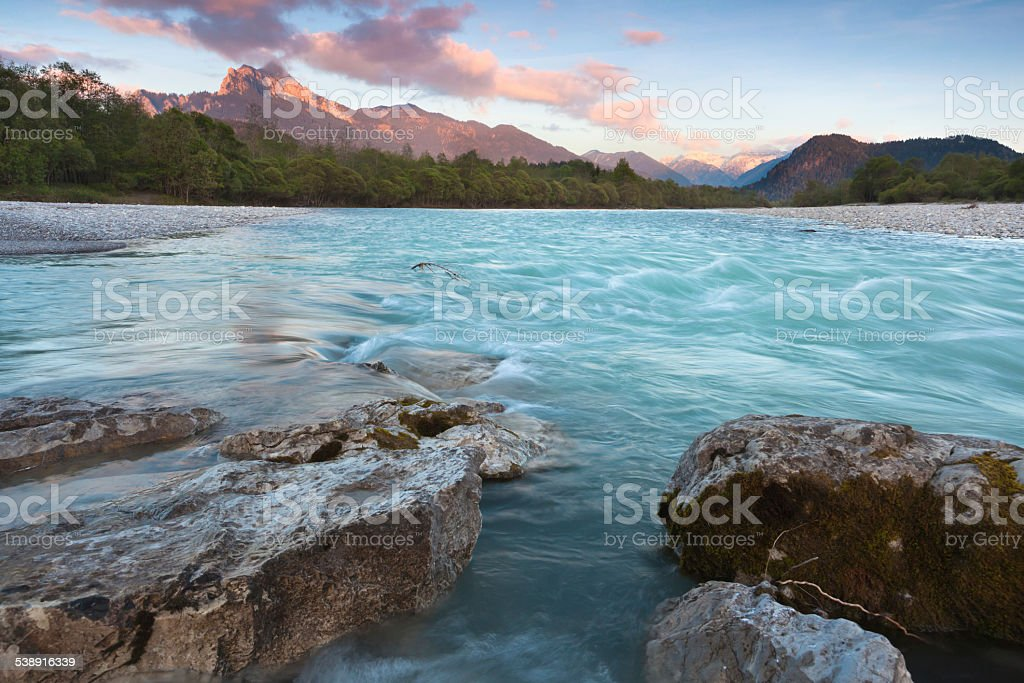 evening light lechriver, tirol, austria stock photo