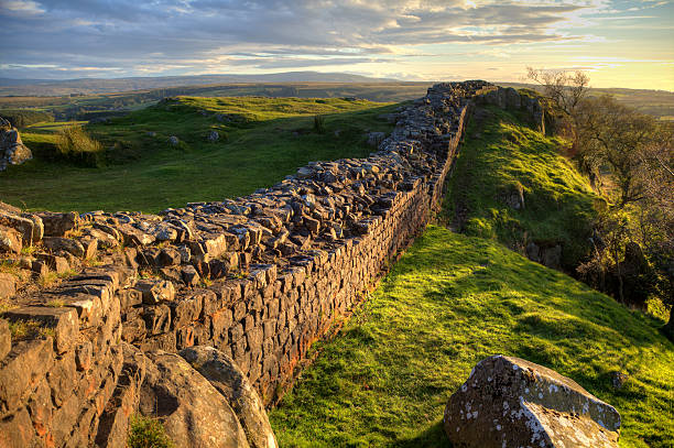 Evening Light on Hadrian's Wall A stretch of Hadrian's Wall at Walton's Crags in Northumberland, England, coloured by the setting sun northwest england stock pictures, royalty-free photos & images