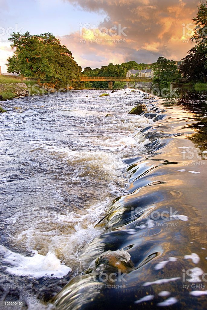 Evening light over weir royalty-free stock photo