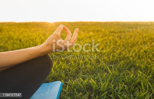 Woman meditating at sunset. Meditation concept.
