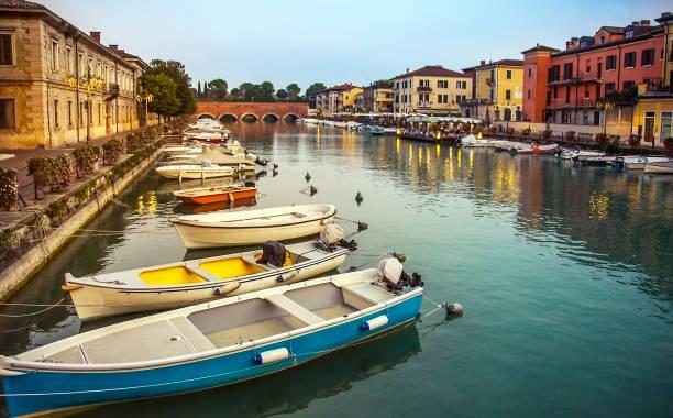 Evening mood at the port of Peschiera Veneto Italy stock photo