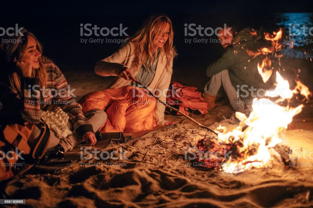 Evening on the beach with friends stock photo