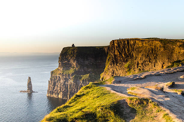 evening over cliffs of moher, co. clare, ireland - cliffs of moher stock pictures, royalty-free photos & images