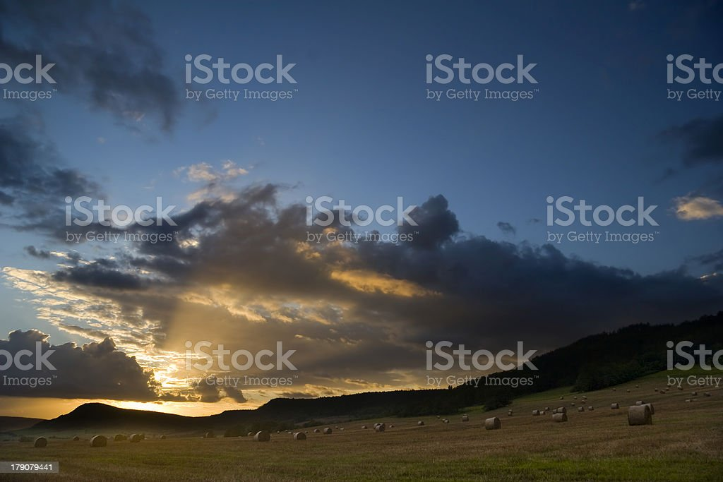 evening over stubble field royalty-free stock photo