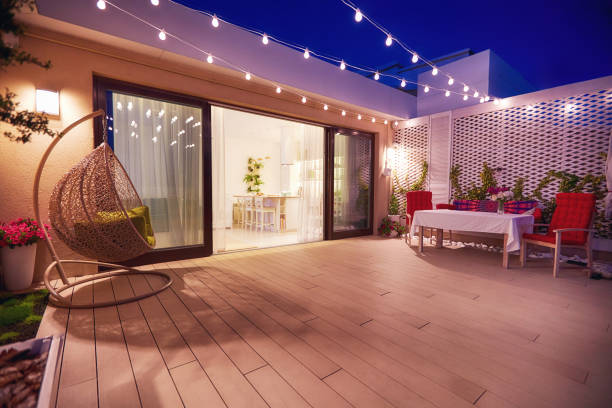 evening patio area with open space kitchen and sliding doors stock photo