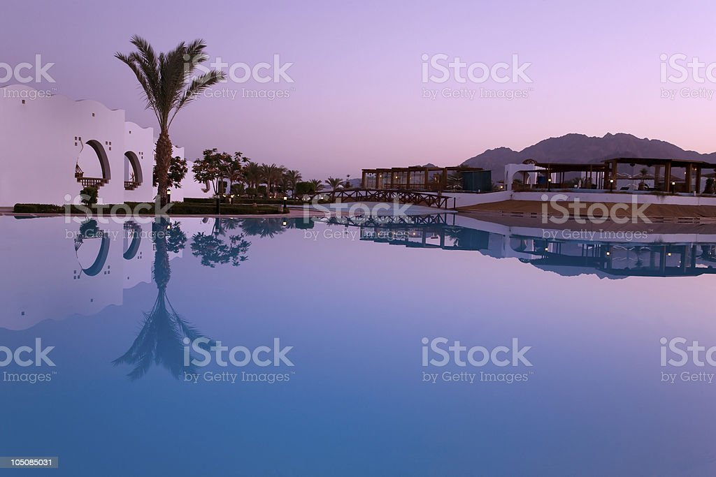Evening reflection in swimming pool stock photo