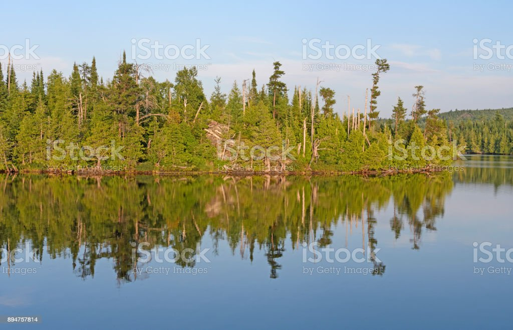 Evening Reflections on a Lake stock photo