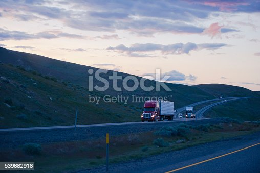 istock Evening road with semi trucks going uphill in Columbia Gorge 539682916
