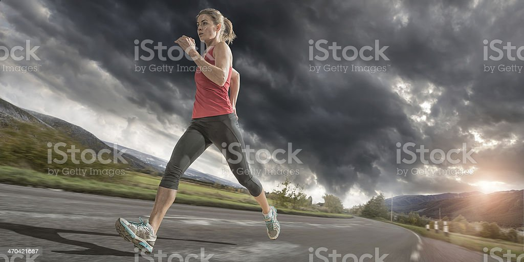 Evening Run Under Stormy Sky stock photo