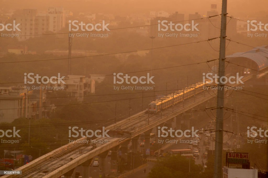 Evening shot of metro train on foggy delhi day stock photo