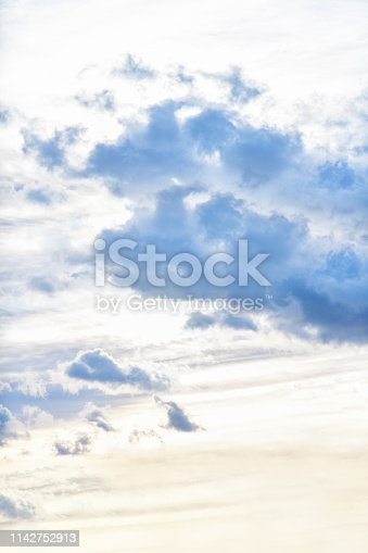 542795898 istock photo Evening sky with dark clouds before the rain, sunset. Vertical photography 1142752913