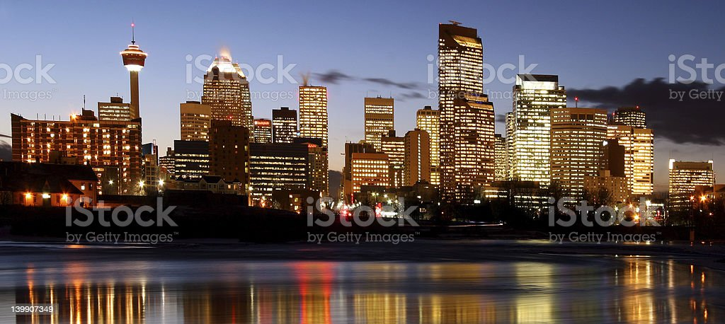 Evening skyline of city lights taken from a lake royalty-free stock photo