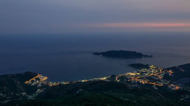Evening skyline of coastline with Budva and Becici tourist resorts stock photo