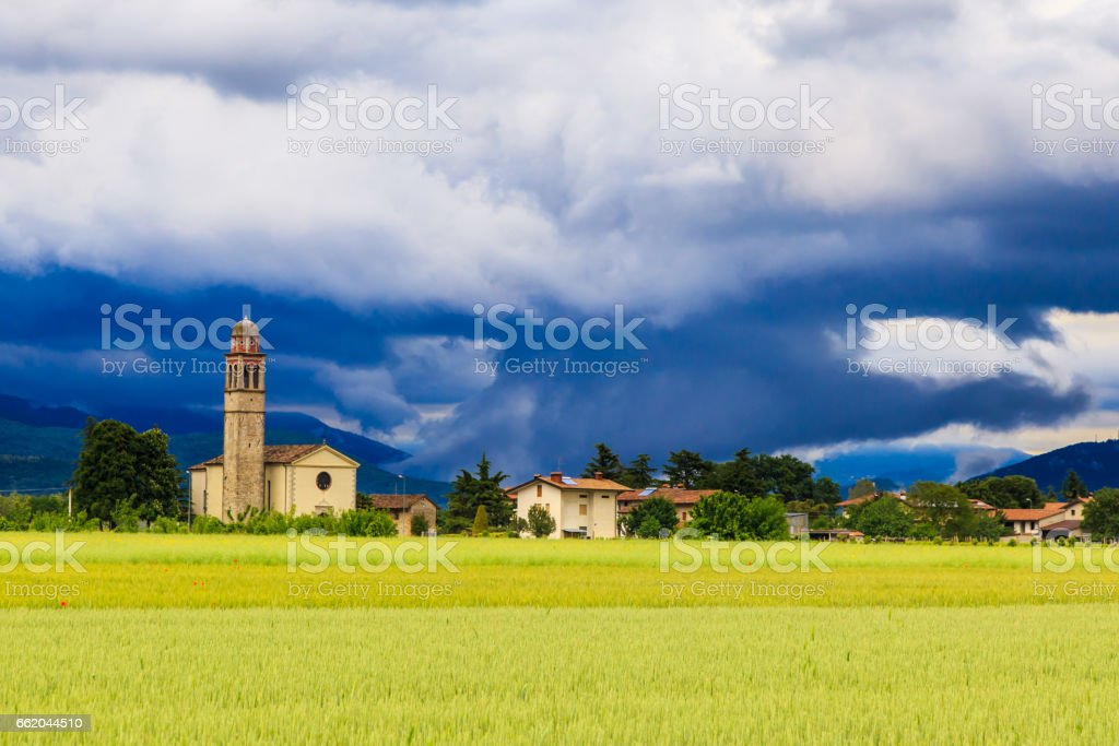 Evening storm over the medieval village royalty-free stock photo