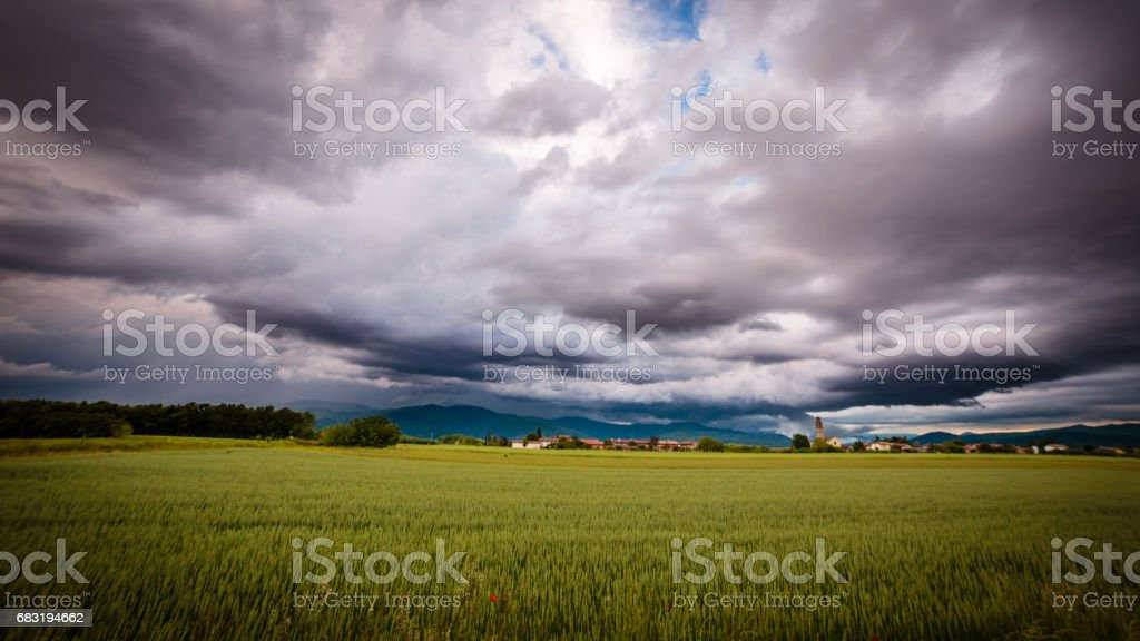 Evening storm over the medieval village 免版稅 stock photo