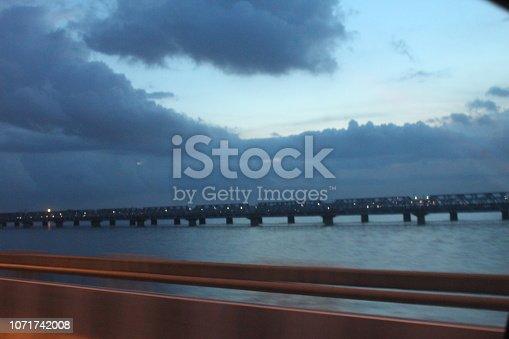 539234032 istock photo evening street lights,vehicles,highway, dusk, motion blurr and cloud sky 1071742008