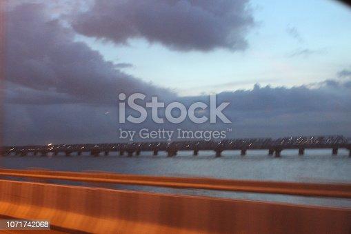 539234032 istock photo evening street lights,vehicles,highway, dusk, motion blurr and cloud sky 1071742068