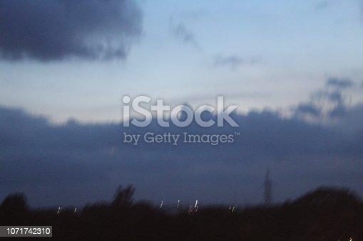 539234032 istock photo evening street lights,vehicles,highway, dusk, motion blurr and cloud sky 1071742310